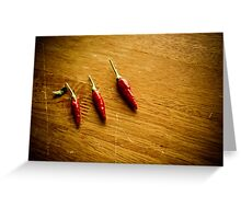 Three red chilies all in a row Greeting Card