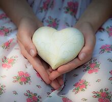 Hands holding a heart by Maria Heyens