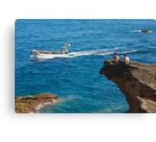 People on an islet Canvas Print