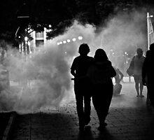 Couple walking through Hyde Park, Sydney. by Distan