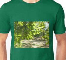 Selective focus on a young branch of a tree with leaves on blurred background Unisex T-Shirt