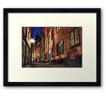 Cobblestone street at night. Framed Print