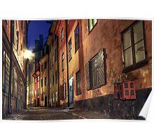Cobblestone street at night. Poster