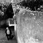 woman climbing hillside street in Portugal by Steve