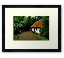 thatched cottage.. Framed Print