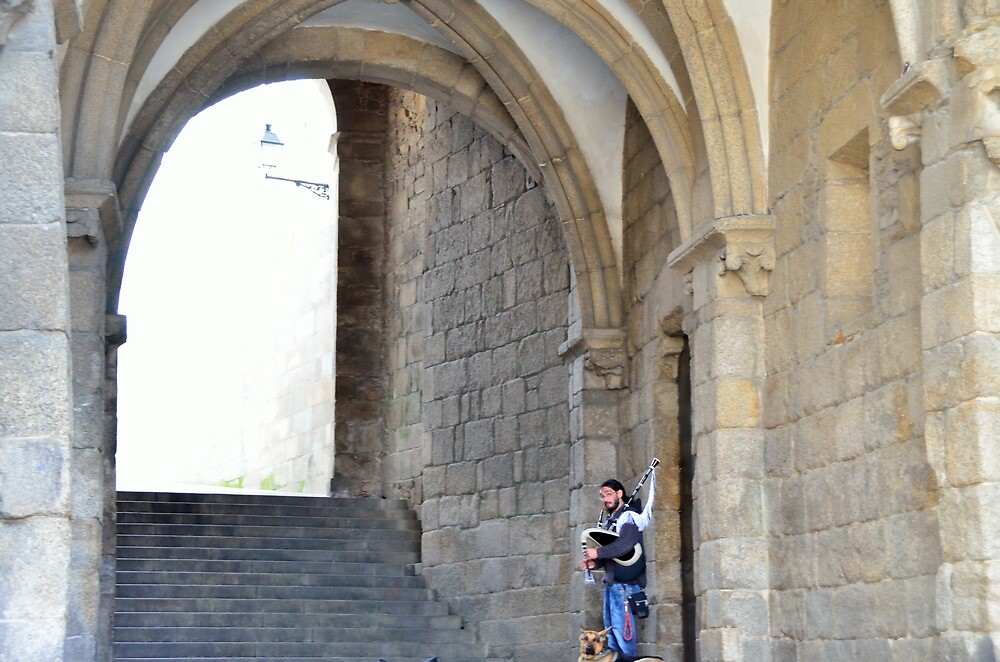 Piper under the arches in Santiago de Compostela by Stephen Frost