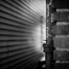 Shadowy Wall with Pipe by Joe Novak-Zarate