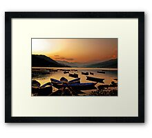 Empty boats at sunset Framed Print