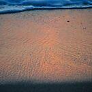 Beach sand at sunset by richard  webb