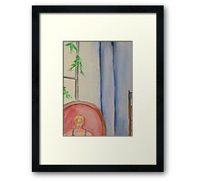 The chair near the window Framed Print