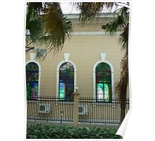 Colourful Ancient church windows shaded by exotic palm trees Poster
