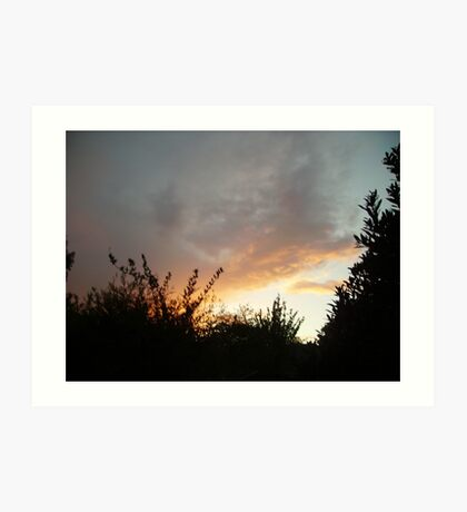 Sunset with red clouds and silhouettes Art Print