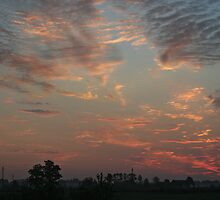 Sky fire in village early morning by Antanas