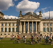 Bicyclists In Front Of Reichstag, Berlin, Germany by Dmitry Shytsko