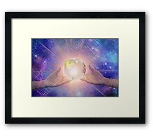 Hands with a Glowing Earth Framed Print