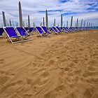 Footsteps and deck-chairs in the sand, Italy by Marita Toftgard