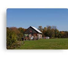 Roadside Gems - Sign Covered Wooden Barn Canvas Print