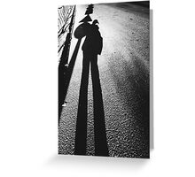 human shadow superimposed with traffic sign shadows Greeting Card