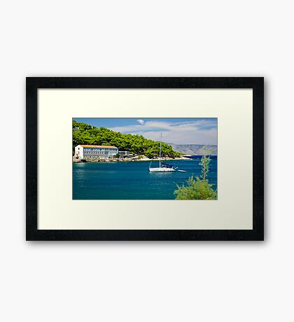 Boat on blue sea Framed Print