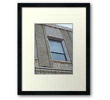 Blue Window in Yellow Brick Wall Framed Print