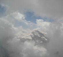 A Peek Through the Clouds - Mt. Shilthorn, CH by Danielle Ducrest