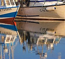 Two boats and their reflection by cclaude