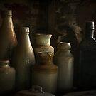 Antique bottles by Rosalie Dale