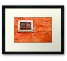 Window on orange wall Framed Print