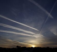 Sunrise and chemtrails by DEB VINCENT