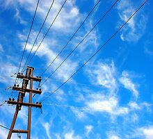 Upward view on power lines and electric pole by vladromensky
