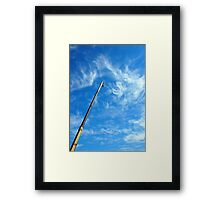 Boom of the crane on a diagonal against a blue sky  Framed Print