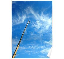 Boom of the crane on a diagonal against a blue sky  Poster