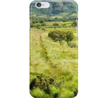 fence leading to rocky green mountains  iPhone Case/Skin