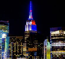 Empire State Building Lit in Blue by raymondwarenyc