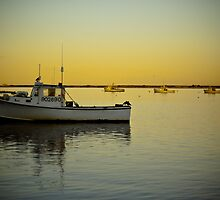 a fishing boat at the Chatham fish pier by apsjphotography