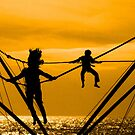 Boy and girl jump by Jasna