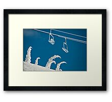 Snow sculptures and frozen chairs Framed Print