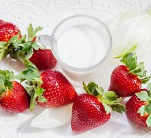 strawberry and glass of milk on white plate by Sviatlana Kandybovich