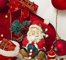 Santa Claus and Christmas candle by Sviatlana Kandybovich