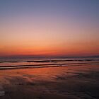 sunset on the beach by Jodie E