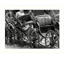 A Calcutta rickshaw wallah relaxes in the sun Art Print