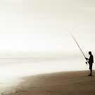 Fishing alone on the Ocean Beach by yurix