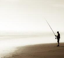 Fishing alone on the Ocean Beach by yurix