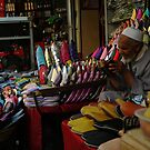 Shoeseller in the souk by Jodi Fleming
