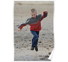 Child jumping for joy on the beach. Poster