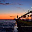 Sunset at the Grand Haven Pier by Debbie  Maglothin