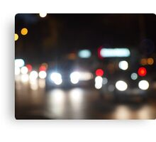 Abstract night scene in the city on the road Canvas Print
