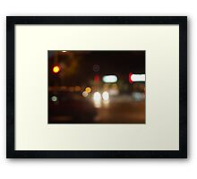 Blur and defocused lights from the headlights of cars Framed Print