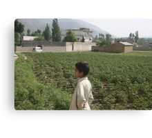 Pakistan- An Afghan boy  view the house of former al-Qaida leader Osama bin Laden Canvas Print