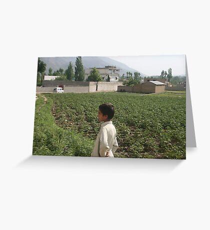 Pakistan- An Afghan boy  view the house of former al-Qaida leader Osama bin Laden Greeting Card